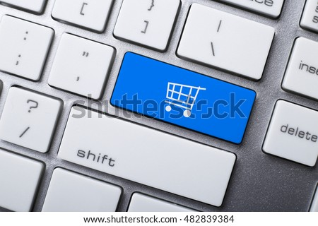 Online shopping or internet shop concepts, with shopping cart symbol on the keyboard. #482839384