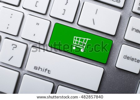 Online shopping or internet shop concepts, with shopping cart symbol on the keyboard. #482857840