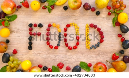 Fruits made word food. Word food on a wood background. Fruits on a table. Fruits on wood background                                #482904883