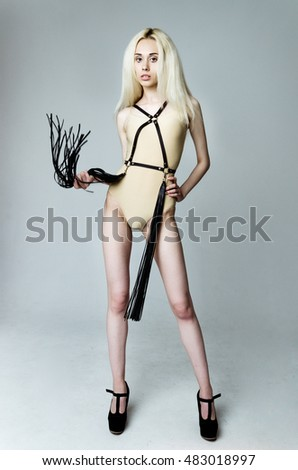 Blonde girl wearing bodysuit and black leather belt #483018997
