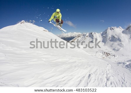 Flying skier on mountains. Extreme winter sport. #483103522