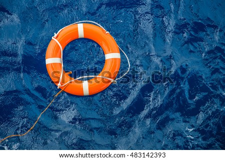 Safety equipment, Life buoy or rescue buoy floating on sea to rescue people from drowning man. Royalty-Free Stock Photo #483142393