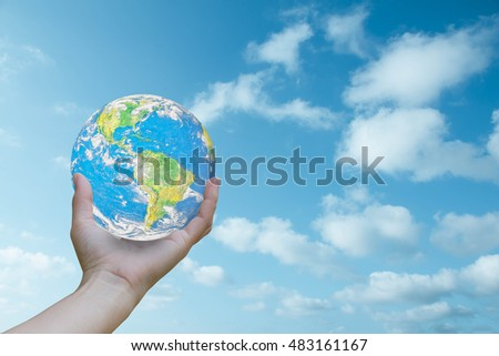 World Human hands the sky in the background blurred.God created the world.Environment Day Ecology concept.Elements of this image furnished by NASA. #483161167