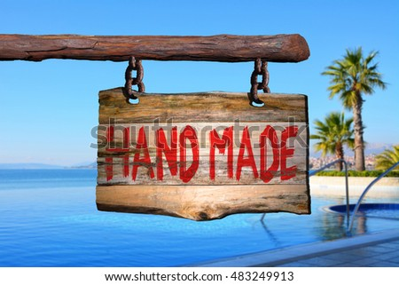 Hand made motivational phrase sign on old wood with blurred background #483249913