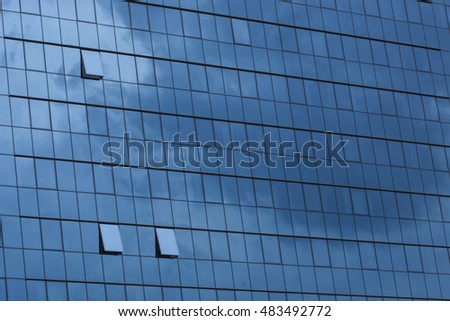 Sky reflecting in windows of office building #483492772
