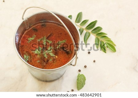 Rasam - South Indian soup using tamarind water tomatoes and lentil, selective focus #483642901