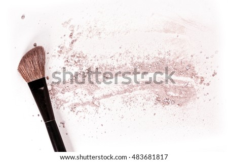 Makeup brush on white background, with traces of powder and blush on it. A horizontal template for a makeup artist's business card or flyer design, with plenty of copyspace