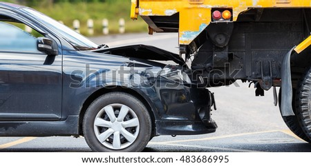 Accident on the road involving black car and yellow truck in Phuket, Thailand #483686995