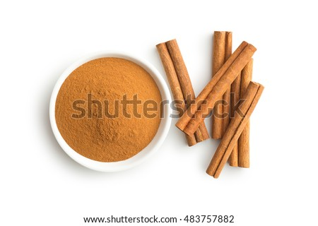 Cinnamon sticks and ground cinnamon isolated on white background. Top view. Royalty-Free Stock Photo #483757882