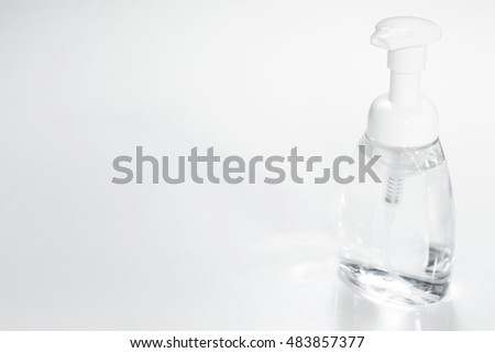 Hand sanitiser foam pump. Free space for text and selective focus. Cleaning for protect yourself from covid19. #483857377