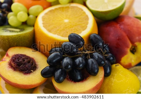 Fresh fruit slices. Grape, apple, kiwi fruits. Background of healthy fresh fruits #483902611