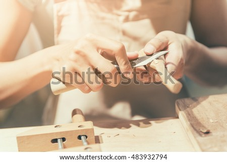 woman carpentry at home, wooden work concept #483932794