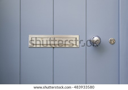 Mailboxes on a door, detail of a mailbox for correspondence, letters #483933580