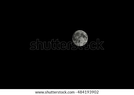 The moon in the black sky. Night. Space.