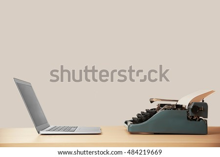 Old typewriter and laptop on table. Concept of technology progress #484219669