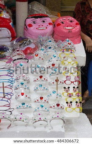 Hanoi VIetnam September 16 2016 Traditional colour decorations, mask, lantern, toys in mid-autumn festival of Asia, they're sold a lot in Hang Ma street in the Hanoi's old quarter #484306672