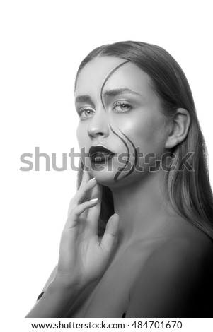Beauty face of sexy girl with creative face art isolated on white background. Studio portrait. Black and white #484701670