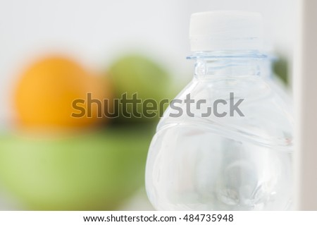 Bottles of cold and refreshing mineral water in refrigerator #484735948