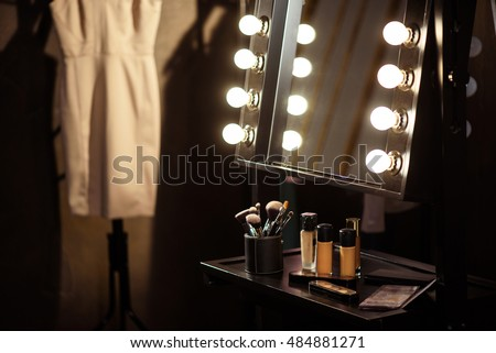 Make-up products and dress backstage Royalty-Free Stock Photo #484881271