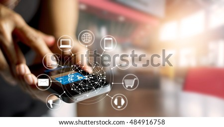 Man using mobile payments online shopping and icon customer network connection on screen, m-banking and omni channel  Royalty-Free Stock Photo #484916758