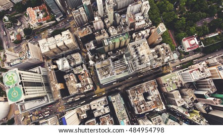 Top view aerial photo from flying drone of a developed China metropolitan with office skyscrapers and business center. HongKong city with tall buildings and development transportation infrastructure Royalty-Free Stock Photo #484954798