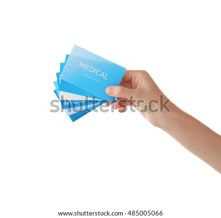 Hand holding cards isolated on white #485005066