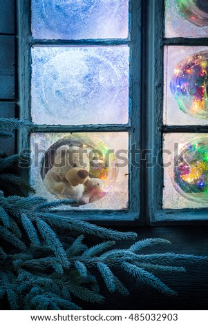 Teddy bear in frozen window for Christmas #485032903