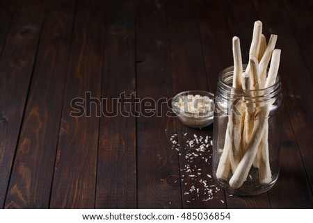 Roots of horseradish in a glass jar with space for text #485036854