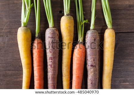 Organic Raw Carrots On Vintage Rustic Wood Texture Table Background. Selective Focus. Defocused. #485040970