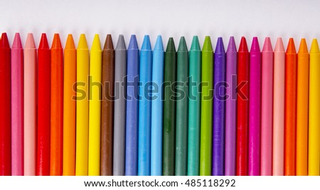 Crayons space background lined up isolated on white background with copy space #485118292