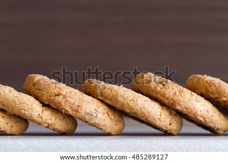 Several chocolate chip cookies on dark background. Close-up #485289127