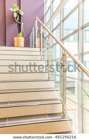 Stairs leading to mezzanine where is standing potted plant #485296216