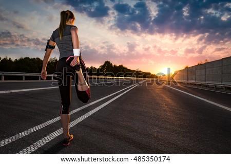 stretching run runner road jogging clothes flare sunset street fitness cross sunbeam success running sportswear  #485350174