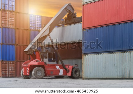 Forklift truck lifting cargo container box in logistic industrial area #485439925
