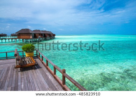 beach with water bungalows at Maldives #485823910