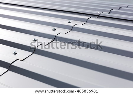 gray corrugated metal cladding on industrial building roof #485836981