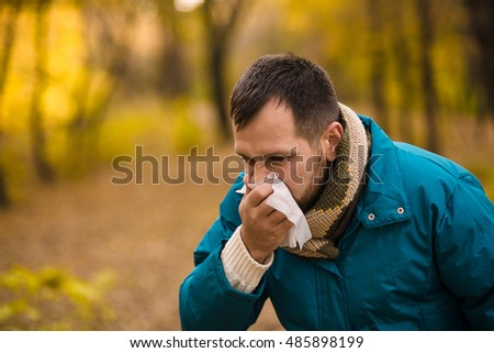 ailing man in the autumn outdoor #485898199