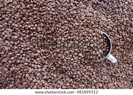 roasted coffee beans with cup and background #485899312