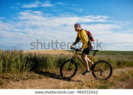 Cyclist Riding the Bike on the Trail in mountains #486032662