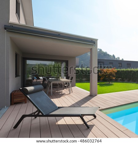 modern house with pool, lounger sun by the pool #486032764