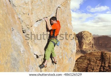 Rock climber to climb the wall. #486126529