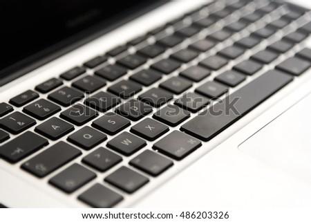 AZERTY black Keyboard of a silver modern laptop #486203326