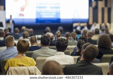 Business People Concept and Ideas. Large Group of People at the Conference Watching Presentation Charts on Screen in Front of Them. Horizontal Image #486307231