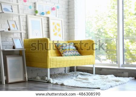 Children room interior design with yellow sofa