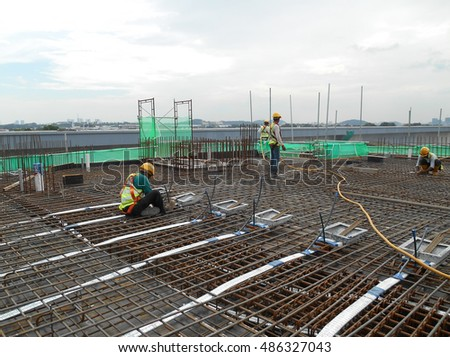 MALACCA, MALAYSIA -JULY 21, 2016: Pre-stress cable ducting function to cover the prestressed cable at the construction site. It is a technology to get better concrete slab quality with larger span.    #486327043