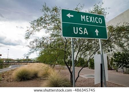 Signpost at the US-Mexican border Royalty-Free Stock Photo #486345745