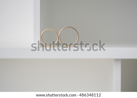 Two wedding rings on a white background.. Mr. and Mrs #486348112