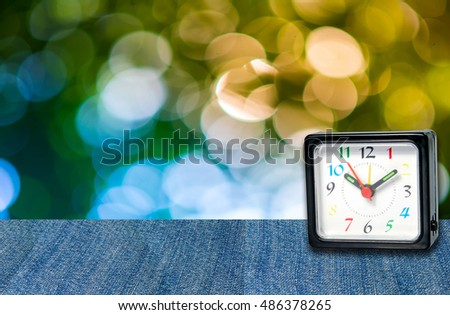 The clock on the background and bokeh. #486378265