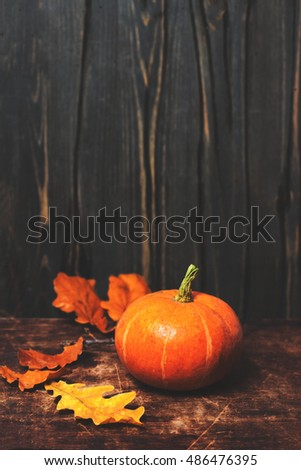 Rustic autumn still life Card with pumpkins and leaves on vintage wooden table. Happy Thanksgiving background