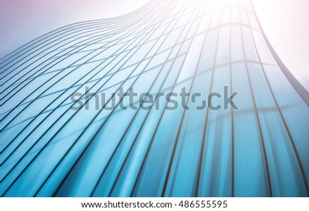 Panoramic and perspective wide angle view to steel light blue background of glass high rise building skyscraper commercial modern city of future. Business concept of success industry tech architecture #486555595